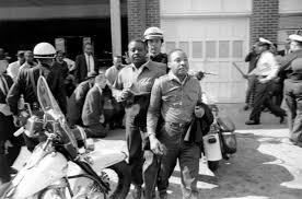 Rev Ralph Abernathy left and Rev Martin Luther King Jr are removed by a policeman as they led a line of demonstrators into the business section of Birmingham Alabama on April 12 1963 AP 650x430 560x370
