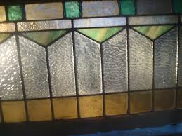 this window only has one pane on the edge which has a bb hole and i am told its an easy fix since its on the edge great colors ambers greens