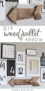 learn how to create this simple rustic wood pallet arrow lovegrowswild com