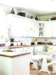 kitchen cabinet decorating ideas top of kitchen cabinet decor kitchen cabinet decor ideas for decorating above