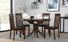 hudson round dark wood extending dining table with 6 oxford dark chairs