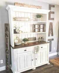 an antique cupboard with charming farmhouse decor