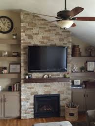 airstone fireplace with regency insert and floating shelves for our living room finally finished and