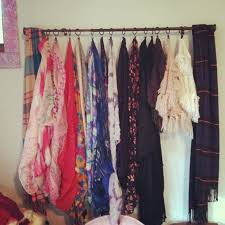 Hang scarves on a shower curtain rod. So much better than piling them in the