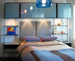 12 year old boys custom bedroom design including modular storage units and bed color selected by 12 year old client headboards are textured vinyl