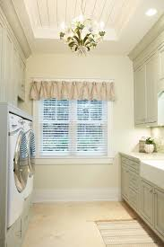 make your laundry room shine with a pretty chandelier photo credit traditional laundry room