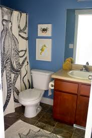 amazing paint ideas with blue wall and granite tile floor plus white toilet and wooden cabinet