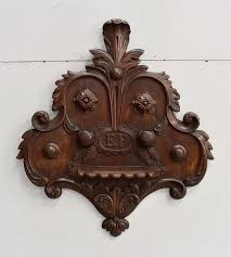 antique carved oak wall pipes holder