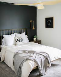 Dark colors like navy, black and deep green can make accent walls feel dramatic. How To Style A Black Accent Wall In A Bedroom Clare