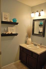 half bathroom ideas photos. floating storage with mirror vanity and sconces plus cabinets for half bathroom ideas photos n