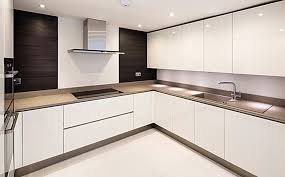 a designer minimalist kitchen featuring porcel thin porcelain wall and floor tiles laid by gb