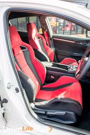 inside there are deep red bucket seats which have the look of race seats but without the discomfort the rear seats are plain black though with red belts