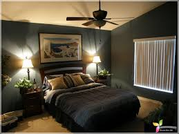 male bedroom ideas. bedroom:masculine bedroom decor ideas with white bedding sets and black covered floor plus orange male