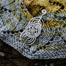 need a new shawl pin to go with your new shawl we have limited quantities available of two beautiful handmade shawl pins picked out to go beautifully with