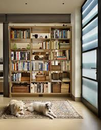 contemporary entry with frosted glass door and homemade bookshelves also white floor large