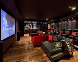 theatre room lighting ideas. Wide Home Theater Design With Dark Leather Sofas And Red Sofa On Natural Laminate Wood Flooring Theatre Room Lighting Ideas C