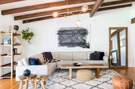 29 a mid century living room in studio city california is warm and cozy thanks to wood flooring and wood beam ceilings illuminating the e is the