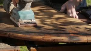 carpenter restoring old furniture grinding of old wooden countertop slow motion stock footage