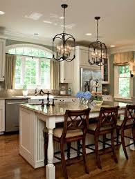 oil rubbed bronze fixtures and hardware with stainless steel appliances light granite countertops cabinets kitchen counter lighting r41 fixtures