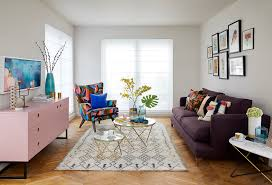 open plan living room with pale off white walls and oak parquet floor signauture armchair