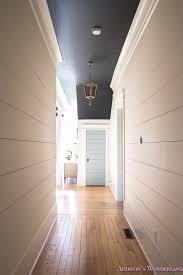 hallway white walls shiplap black ceiling alabaster inkwell lantern cau blue door stardew uncertain grey whitewashed hardwood flooring 5 of 15
