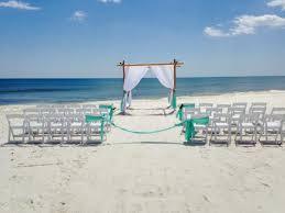 beach wedding chairs. Beach Wedding White Garden Chairs And A Bamboo Chuppah D