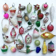 A nice collection of antique Xmas ornaments on a German feather tree.