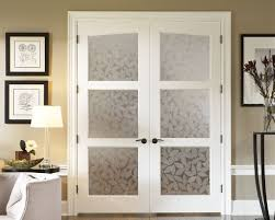 custom interior french doors with decorative frosted glass panels