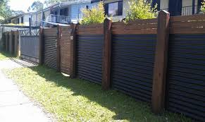 metal Privacy Fence Wood and corrugated metal create a visually
