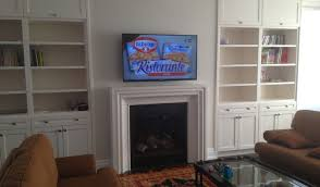 tv wall mount installation with wire concealment over hang tv above gas fireplace hang tv above