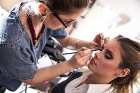 a makeup artist working on their client