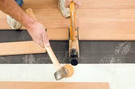 worker installing new uru hardwood floor