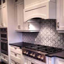 kitchens with white cabinets and backsplashes. Image Of: Black-Countertops-and-White-Cabinets Kitchens With White Cabinets And Backsplashes