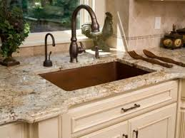 luxurious kitchen elements including a hammered copper sink basin and granite counter tops see more