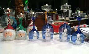 santa and snowman candle holders to cherish
