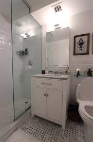 Small bath with glass shower.