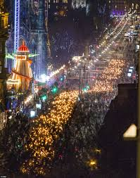 edinburgh lighting up time. lighting up the capital: parade made for a majestic sight as hundreds of edinburgh time i