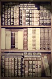 old library cover books on shelves stock photo