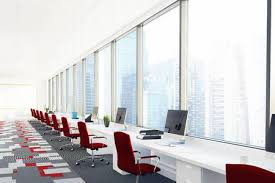 Open Office Design Impressive Open Office Room With White Computer Desks Red Chairs And A Stock