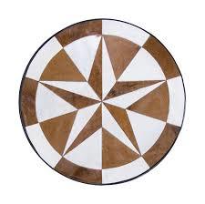 brown round cowhide rug