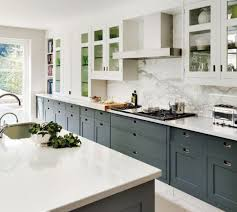 two with white kitchen cabinets with grey countertops