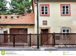 Attractive Download Brown Wood Fence In Front Af A House With Orange Shingles Roof  Stock Photo