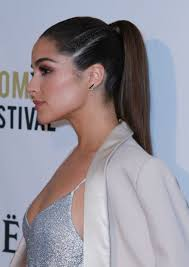 olivia culpo with side braided ponytail hairstyle