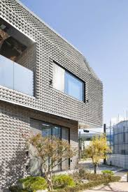Angled Bricks Make The Exterior Of This House Textured And Prickly  Modern  House ExteriorsModern HousesBrick ...