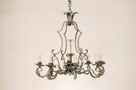 french painted iron eight light iron chandelier with acanthus leaves and scrolls in good condition