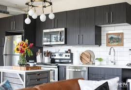 tips and ideas for styling and stocking an apartment kitchen inspired by charm