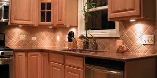 with the new counter the backsplash tile can be updated and eliminate the need for the granite backsplash here is a picture of a tiled backsplash area