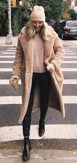 winter outfit inspiration hat fur coat sweater pants boots