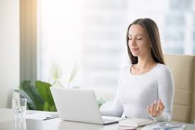 office meditation. Young Woman Practicing Meditation At The Office Desk A