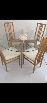 round glass table x4 chairs